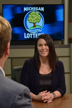 Meagen Granberry is interviewed after being presented with an Excellence in Education award from the Michigan Lottery.