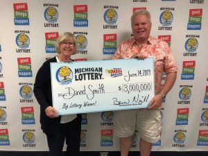 David and Kris Smith smile after claiming a $3 million Mega Millions prize.