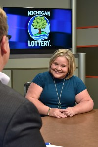 Heather Dahl is interviewed after being presented with an Excellence in Education award from the Michigan Lottery.