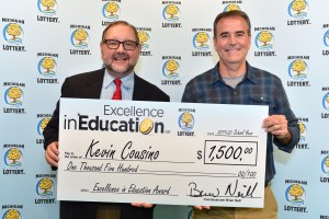 Kevin Cousino (right) poses for a photo with Michigan Lottery public relations director, Jeff Holyfield, after accepting his Excellence in Education Award.