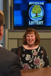 Kirsten Billeter is interviewed after being presented with an Excellence in Education award from the Michigan Lottery.