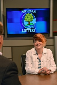 Tracey Luce is interviewed after being presented with an Excellence in Education award from the Michigan Lottery.
