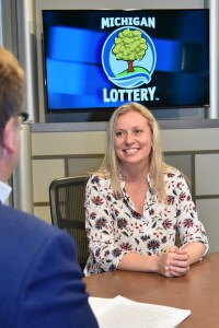 Sarah Soper is interviewed after being presented with an Excellence in Education award from the Michigan Lottery.