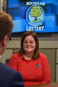 Amber Keathley is interviewed after being presented with an Excellence in Education award from the Michigan Lottery.
