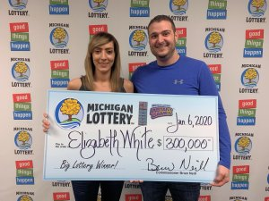Elizabeth White and her boyfriend, Tyler Woodward, smile after claiming White's $300,000 prize.