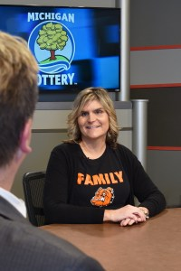 Karen Storey is interviewed after being presented with an Excellence in Education award from the Michigan Lottery.