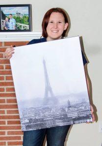Amanda holding black and white photo of foggy Eiffel Tower