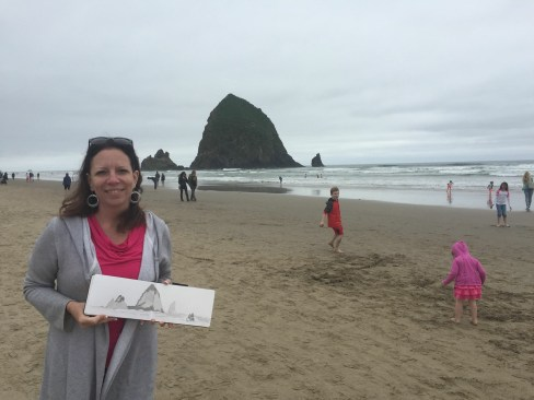 Elizabeth with sketchbook at beach in Oregon