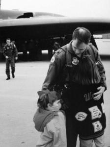 Me with my sister hugging my dad after a long successful mission on the B-2 Stealth Bomber in 1994