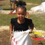 Little girl enjoys sack race at Wisconsin State Fair.