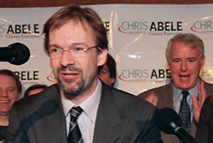 Chris Abele delivers his acceptance speech following Jeff Stone conceding the election to him for Milwaukee County Executive. Mayor Tom Barrett proudly looks on, who was an early supporter of Abele for the job. (Photo by Robert A. Bell)