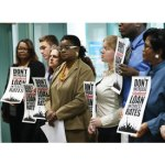 Gwen Moore stands with students in opposition to doubling student loan interest