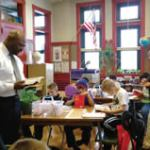 AT&T Pioneers donating 1,660 dictionaries to 3rd graders at 28 Milwaukee County Schools