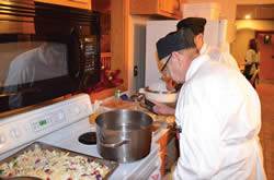 Casino Executive Sous Chef Robert Dietiker prepares dinner for guests of the Ronald McDonald House