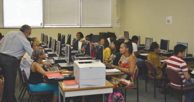 Adult students do classroom work as part of the GED/HSED program at SDC.