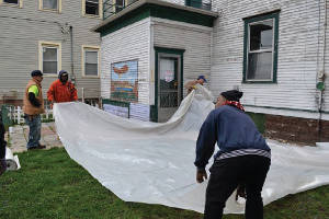 Lead Abatement contractors practice exterior containment during a safety workshop