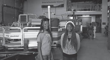 The two HOPE High School students that took part in the first Freshwater Research Expedition to the Mississippi River earlier in the month are Michelle Cooper (left) and Sierrena Taylor (right).