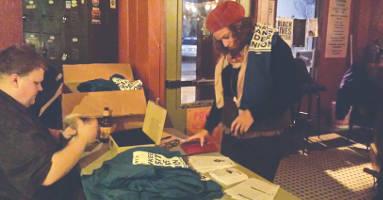 Hillary Wilson, 28, purchases an MTRU t-shirt at Thursday's fundraiser