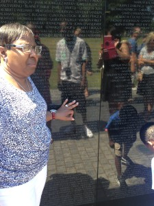 Loretta Scott recently visited the Vietnam Veterans Memorial Wall. Here she is seen touching the name of Willie Bedford.
