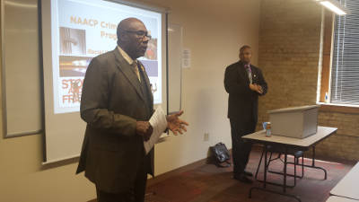 Wendell J. Harris, Sr., 1st Vice President of Wisconsin NAACP State Conference (left), introduces Cartlon T. Mayers, II, Esq. (right), as the keynote speaker of the 2015 NAACP Education Summit on June 13, 1015. Mayers has spent the last two years working for the NAACP collecting, analyzing, and presenting data on the impact of racial profiling in U.S. society.