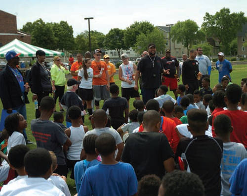 Gilbert talking about football with camp goers.