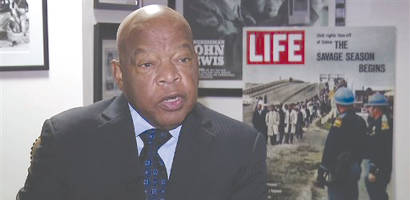 "In this Dec. 22, 2014 image taken from video, U.S. Rep. John Lewis, D-Ga., discusses the historical drama ""Selma"" and civil rights in the United States during an interview in Atlanta. He is one of the legislators who introduced the Voting Rights Advancement Act of 2015. (AP Photo/Alex Sanz)"