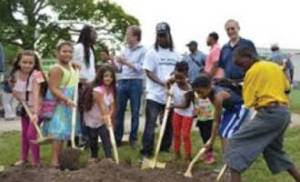 County Executive Abele helps break ground on a new community garden in Moody Park