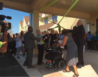On the left, Alderman Russell Stamper, Sister Diana DeBruin, Sister Edna Lonergan. On the right, Mayor Tom Barrett. They all untie a ribbon to signify the opening of the new St. Ann Center -- Bucyrus Campus. Photo by Ariele Vaccaro