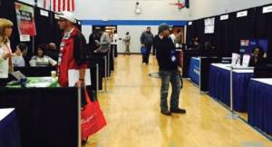 Men explore the job fair at last week's Fatherhood Summit. Photo by Karen Stokes.