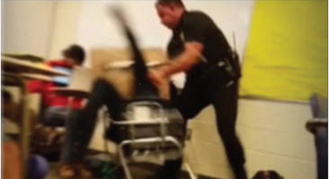 In this screenshot of one of the videos, Officer Ben Fields wrestles 16-year-old girl to the floor before dragging and tossing her across the classroom.
