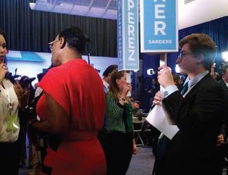 Student journalist interviews Nina Turner. Photo by Mrinal Gokhale.