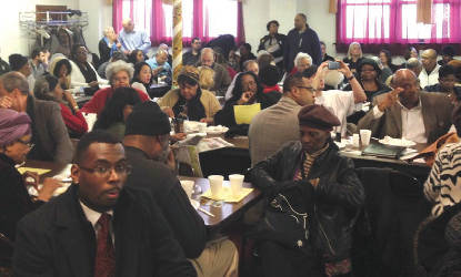 Community members packed the basement of the St. Matthews C.M.E. Church. Photo by Dylan Deprey.