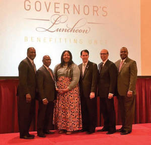 Dr. David Wilson, president of Morgan State University and former chancellor of the University of Wisconsin Colleges and the University for Wisconsin-Extension, Precious Woodley, Gates Scholar, UW-Milwaukee, Gov. Scott Walker, Dr. Michael L. Lomax, president and CEO of UNCF and Gerard Randall, Jr., Executive Director of Milwaukee Partnership Academy