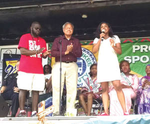 Milwaukee's 5th District Supervisor Marcelia Nicholsan (middle) greets the crowd on Juneteenth (Photo by Mrinal Gokhale).