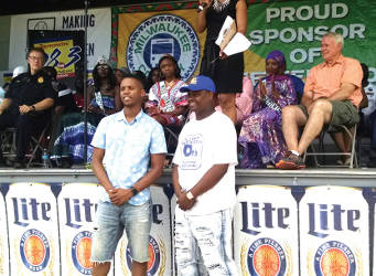 (Left to right) Nicholas Stokes, MKE fellows graduate of Morehouse College and Kalan Haywood of the Milwaukee Youth Council, president of Youth Council are honored at Juneteenth. (Photo by Mrinal Gokhale).