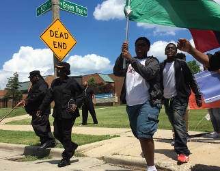 UACB's 8th Grade class marching for a violence-free summer. (Photo By Dylan Deprey)