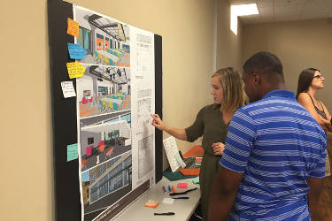 Community members asked questions and used post-it notes to add comments or concerns on the renderings of the new Forest Home Library. Photo by Dylan Deprey.