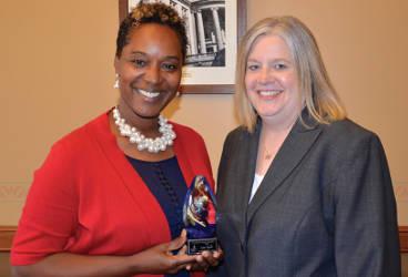 Photo of Senator Taylor receiving her WCA Outstanding Legislator Award in her Capitol office from WCA Deputy Director of Government Affairs, Sarah Diedrick-Kasdorf.