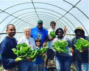will-allen-growing-power-people-holding-lettuce-hoop-house