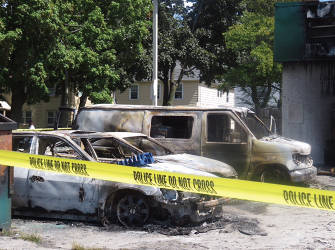 Burned out cars at the BP gas station on Sherman and Burleigh. (photo by Karen Stokes)