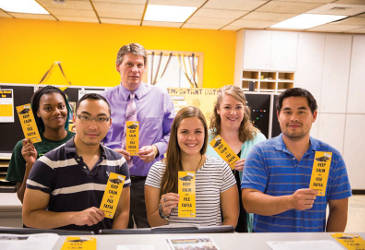 Tim Opgenorth (back row, center) directs the financial aid office at UWM with support from professional staff and a team of student workers. Only a few members are pictured here. More than 80 percent of UWM students receive financial aid.