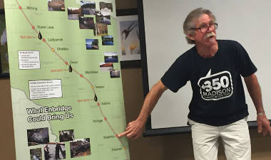 Harry Bennett traces the route Line 61 takes, and the additional pump stations to be included in the upcoming expansion. (Photo by Dylan Deprey)