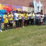 The Running Rebels Unveil Mural at End of Summer Block Party