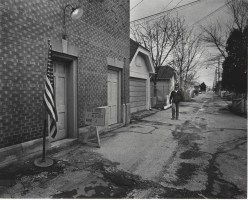 A man walked up the Capitol Dr. alley between 25th and 26th Sts. to vote Tuesday at a fire station. Wednesday, April 5, 1978.