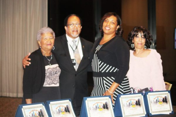 CRUSADER PUBLISHER DOROTHY R. LEAVELL (left) smiles with NNPA President and CEO Benjamin Chavis Jr. after winning five Merit Awards at the organization's annual convention in Houston. To the right are Crusader staff members Marissa Bullock and Doris House. To see more photos visit the Crusader's photo gallery at www.chicagocrusader.com.