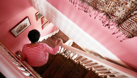 Marie Spiro descends the narrow staircase, a difficulty of living in a 1903 Capitol Hill home, August 7, 2007, in Washington, D.C. PHOTO CREDIT: Andrew Councill For The New York Times