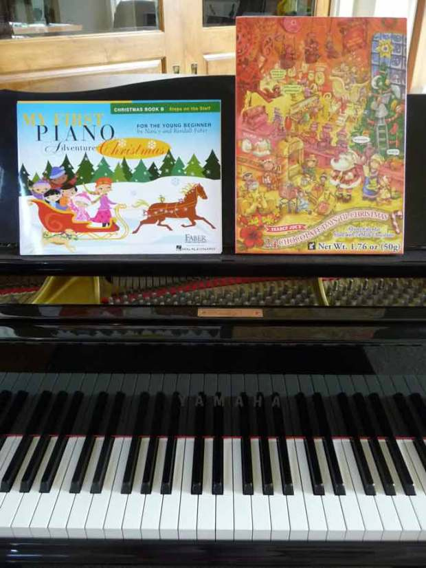 piano with Christmas book and chocolate advent calendar