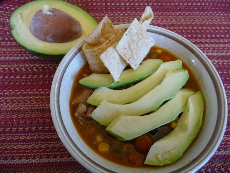 Southwest Chicken Soup with avocado and tortilla strips
