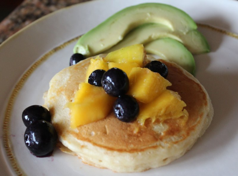 Pancakes with mango, blueberries and avocado