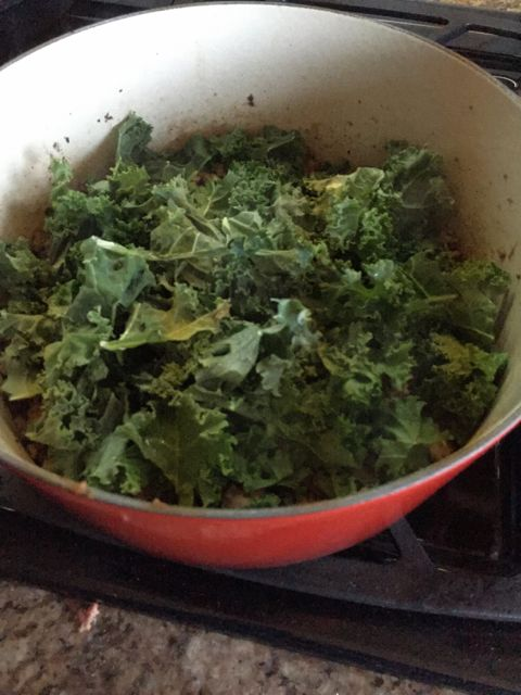 adding kale to meat sauce